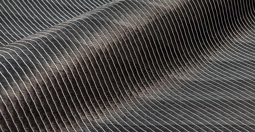 Multiaxiella vävar av kol och glasfiber